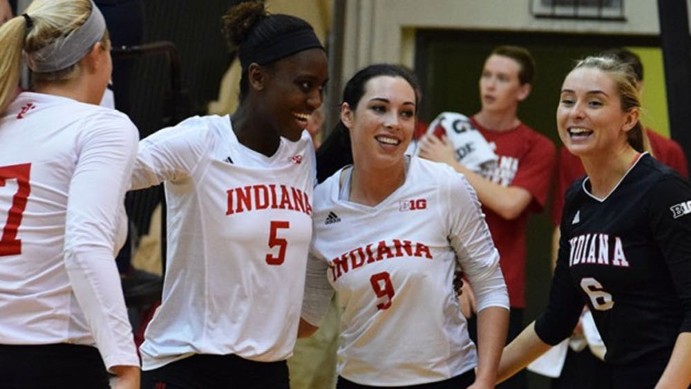 Jazzmine McDonald, Megan Tallman, and Taylor Lebo are all smiles after #5 gets an ace that sends the Hoosiers ahead of the Gophers.