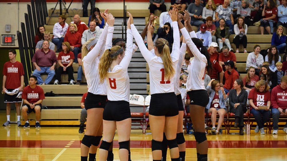 The Hoosiers assemble before the 3rd match to get pumped up for the next set against Minnesota.