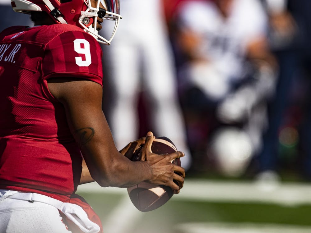 Redshirt sophomore quarterback Michael Penix Jr. holds the ball Oct. 24, 2020 in Memorial Stadium. Penix said he is ready for the team's season opener at Iowa during Big Ten Media Days.