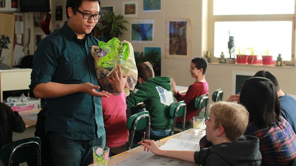 David Chen asks a student to repeat a phrase in Chinese during his class on December 9. Chen rewarded every student with a piece of candy after they had pronounced the phrase correctly.