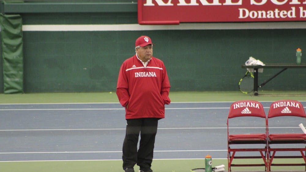 Coach Ramiro Azcui looks on as his team competes in the Winter Invitational Saturday in Bloomington.