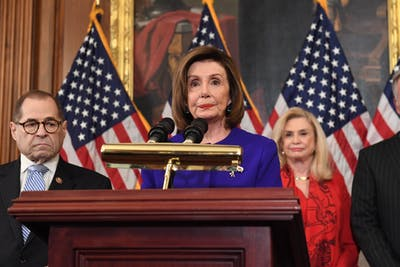 House Speaker Nancy Pelosi, D-CA, speaks next to House Judiciary Chairman Jerry Nadler, left, D-NY, as they announce articles of impeachment for President Donald Trump during a press conference Tuesday at the U.S. Capitol in Washington, D.C.