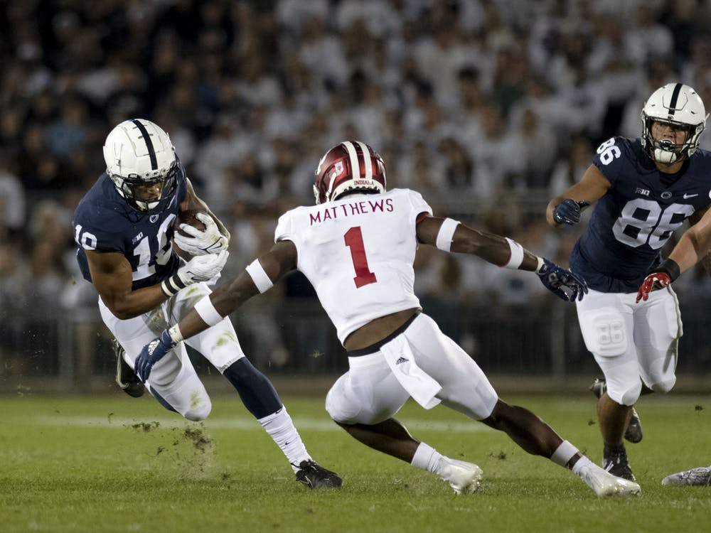 Senior defensive back Devon Matthews attempts to make a tackle against Penn State on Oct. 2, 2021, at Beaver Stadium. Indiana is off this week for their bye week before taking on No. 11 Michigan State for Homecoming.