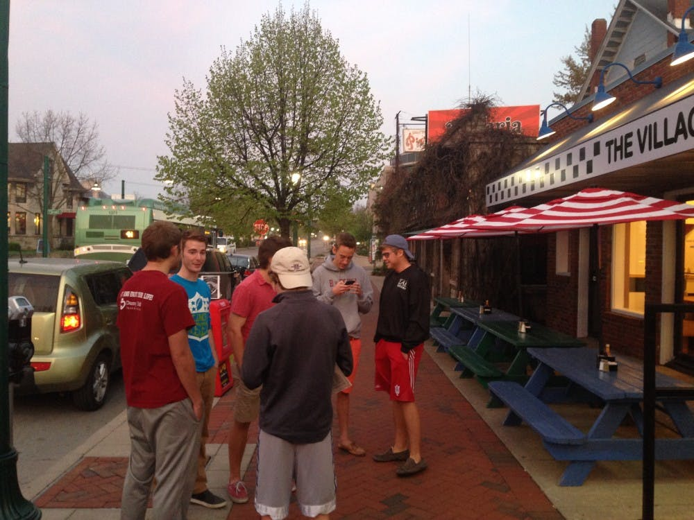 A group of sophomores stand outside of Village Deli on Friday morning. The boys were the first customers in line for the re-opening of the restaurant.