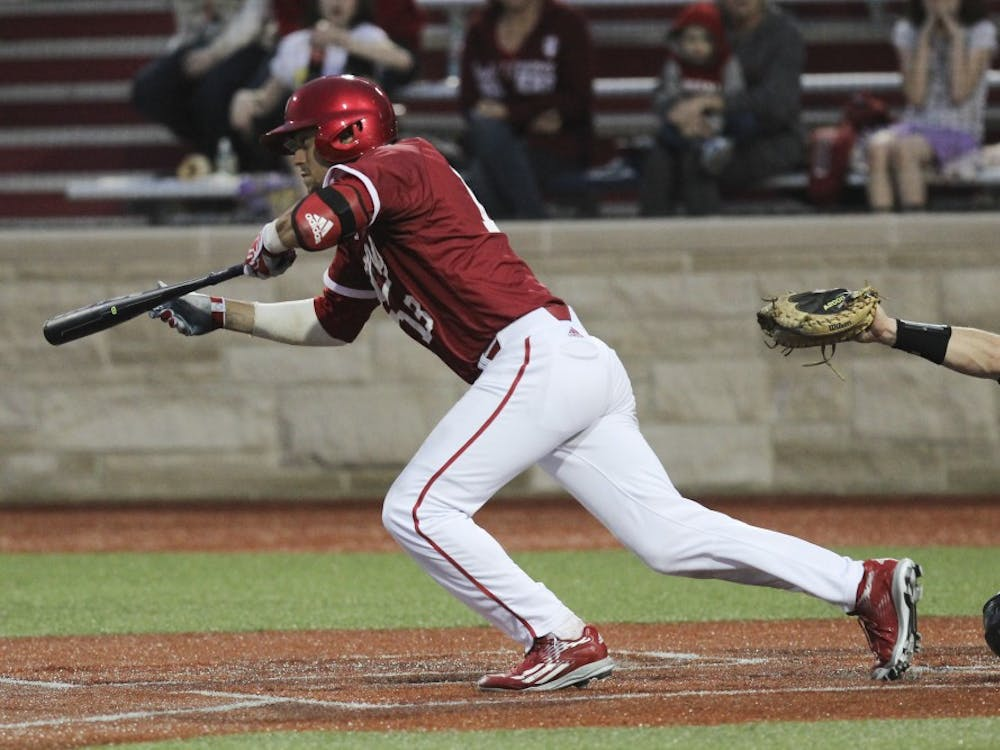 Then-junior first baseman Austin Cangelosi, who is now graduated, bunts in a late inning of play against Northwestern during the 2016 season. IU faced Coastal Carolina on Feb. 19 and won 6-5.