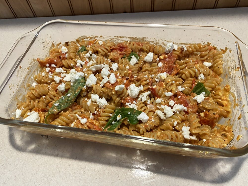 <p>The feta pasta dish popular on TikTok is pictured. The recipe has gone viral on TikTok, consisting of cherry tomatoes, garlic cloves, olive oil, salt, pepper, oregano and a full block of feta cheese.</p>