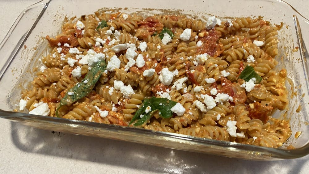 The feta pasta dish popular on TikTok is pictured. The recipe has gone viral on TikTok, consisting of cherry tomatoes, garlic cloves, olive oil, salt, pepper, oregano and a full block of feta cheese.