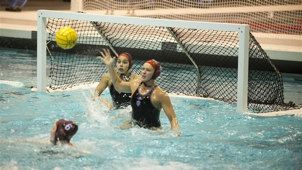 Freshman Goalie Jessica Gaudreault and Junior Attacker Shae Fournier block a shot together during their game against Long Beach State on Feb. 23, 2013, at the Counsilman-Billingsly Aquatic Center. The IU Women's Water Polo team lost the game 7-4 during the weekend-long Fluid Four tournament.
