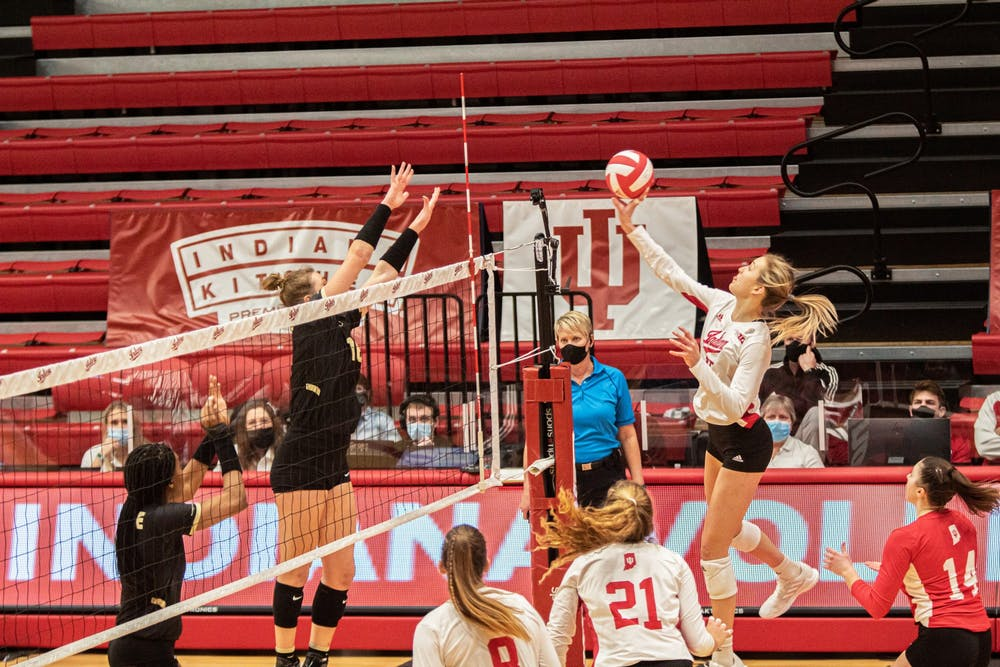 <p>Freshman middle blocker Savannah Kjolhede hits the ball against Purdue on Feb. 23. The Hoosiers will play Maryland at 5 p.m. Friday.</p>