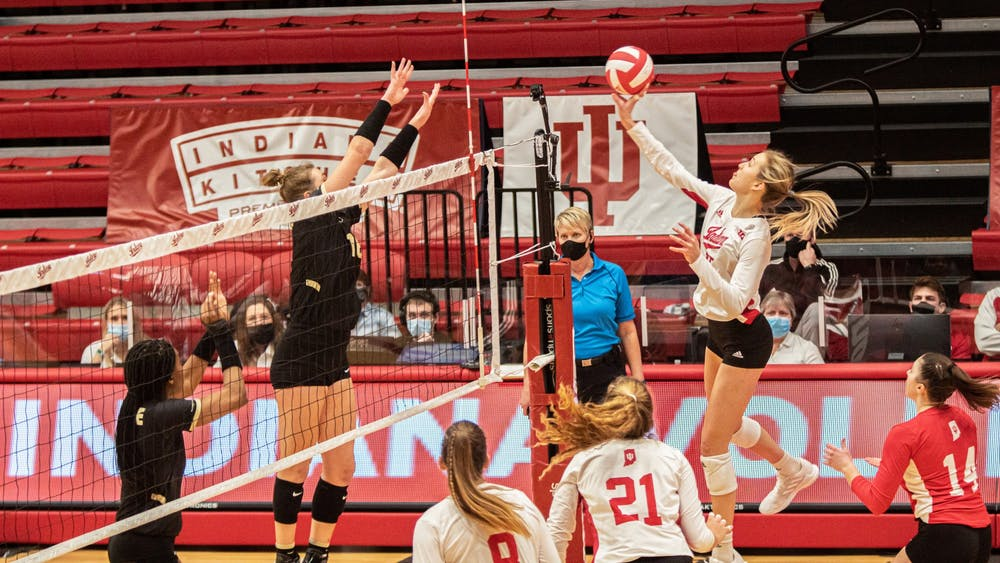 Freshman middle blocker Savannah Kjolhede hits the ball against Purdue on Feb. 23. The Hoosiers will play Maryland at 5 p.m. Friday.