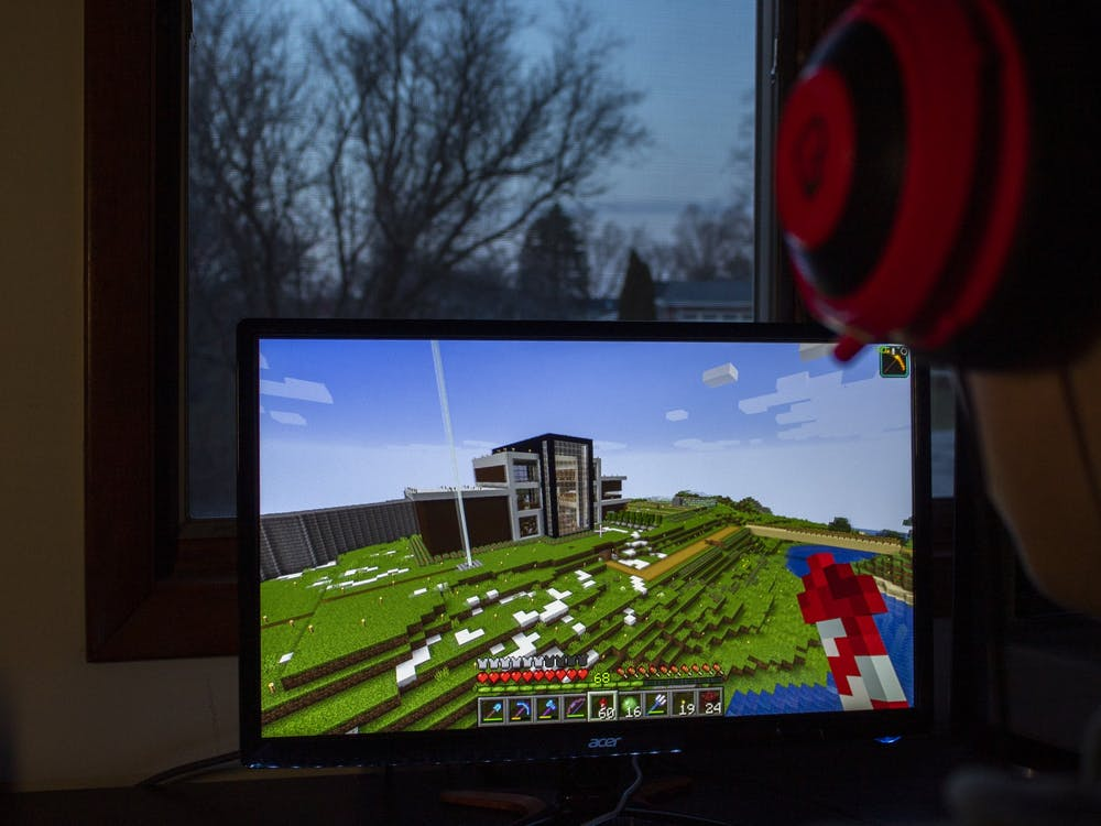 A student plays Minecraft inside during isolation.