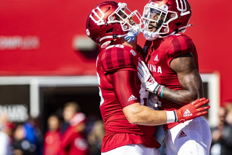 Junior wide receiver Whop Philyor celebrates with redshirt sophomore tight-end Peyton Hendershot after a play Oct. 12 in Memorial Stadium. IU defeated Rutgers 35-0.