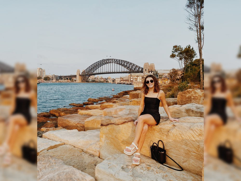 Junior Sydney Tomlinson sits on a rock Jan. 3 outside Sydney Harbour. Tomlinson is studying in Sydney, Australia, this spring.