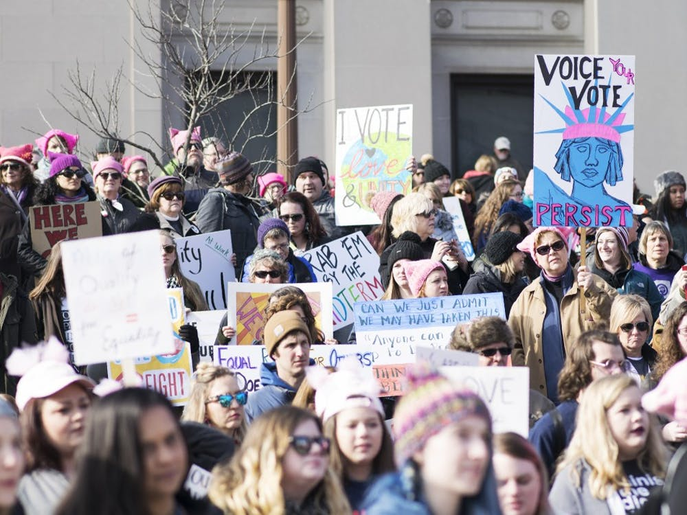 Attendees at the Indianapolis Women's March on Washington on Saturday listen to Sally Tuttle, the chair of the Indiana Native American Indian Affairs Commission. The march began at the American Legion Mall and ended at the Indiana State House and focused on voter turnout for the midterm elections in November.