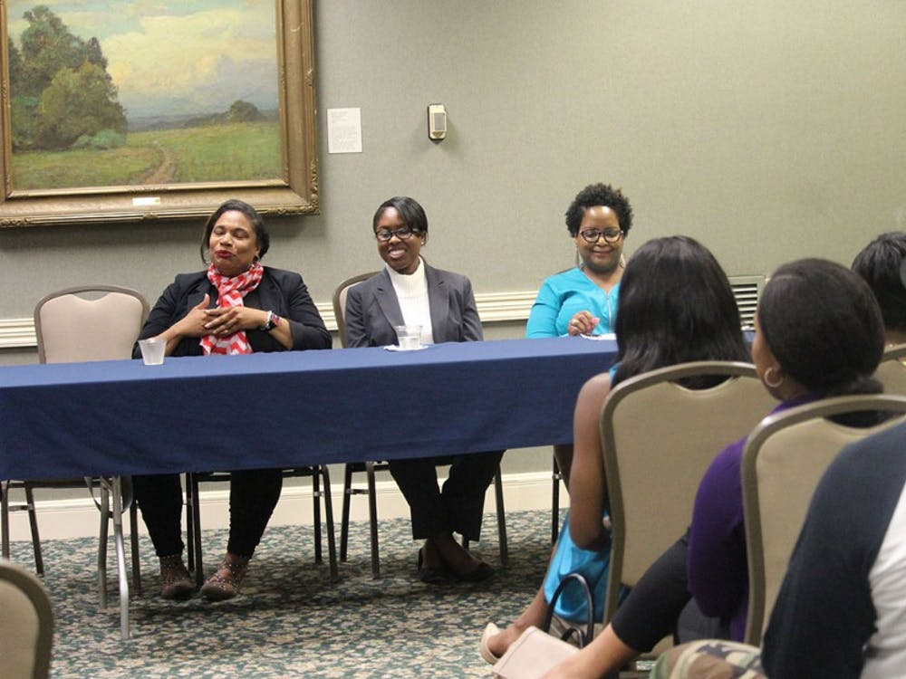 A variety of students and faculty gather together for the a panel event about black women in the STEM field Wednesday evening. Panelists (from left to right) Kimberly Gold, Kristen Hicks, and Erica Jones speak about how it is being a black women in a male dominated industry of engineering.