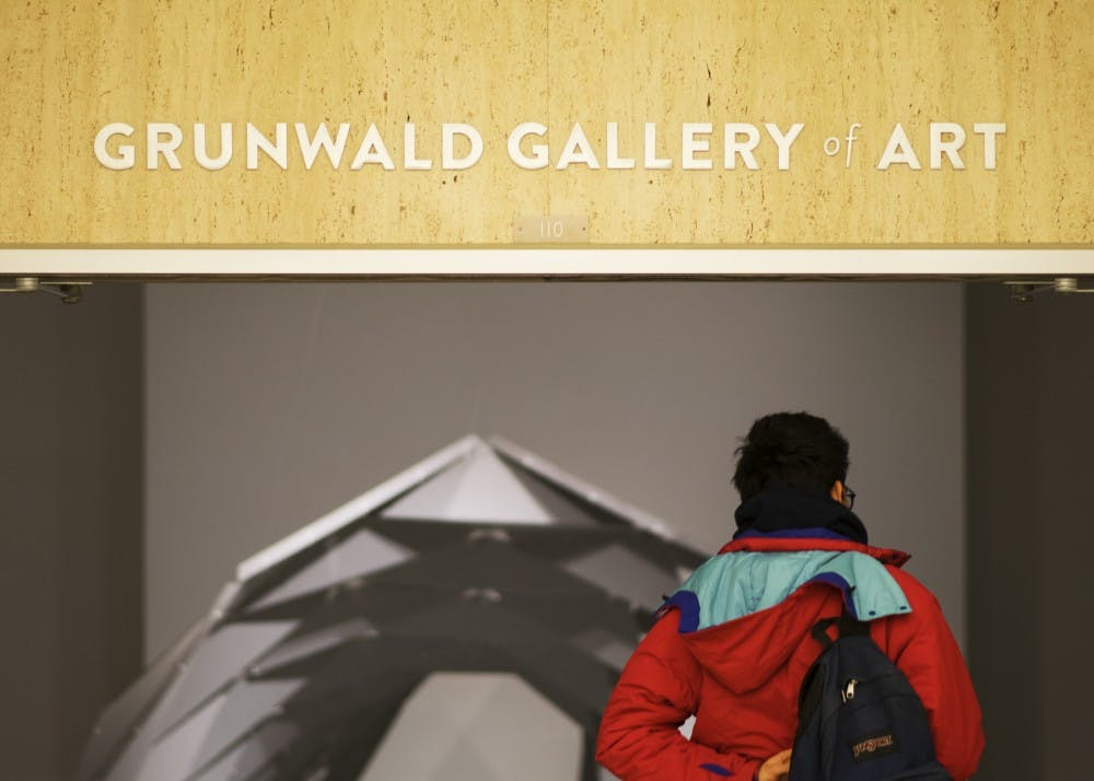 <p>Then-junior Nicolas Martinez enters the Grunwald Gallery of Art, a gallery on the second floor of the Fine Arts Building that features art by professionals and students. The Grunwald Gallery will open two new exhibitions Jan. 11.&nbsp;</p>