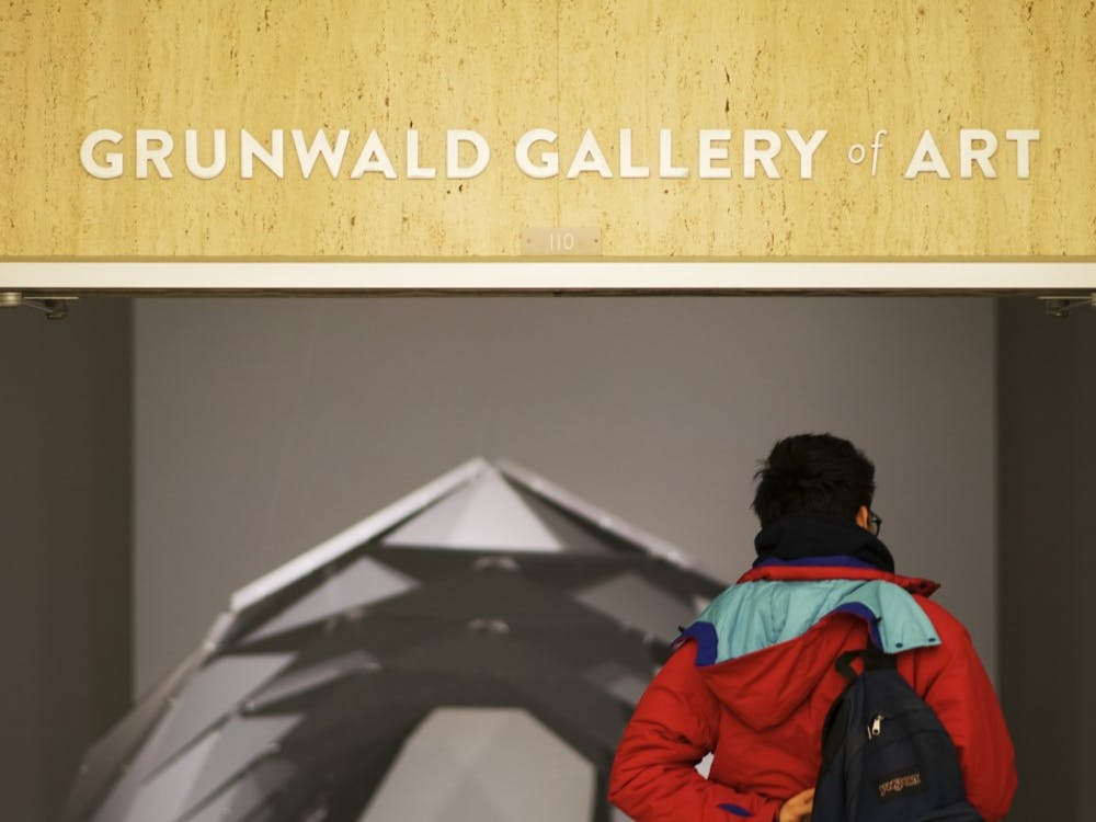 Then-junior Nicolas Martinez enters the Grunwald Gallery of Art, a gallery on the second floor of the Fine Arts Building that features art by professionals and students. The Grunwald Gallery will open two new exhibitions Jan. 11.