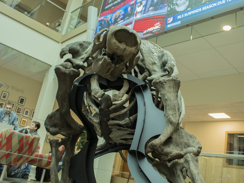 The reconstructed Megalonyx Jeffersonii, a type of giant ground sloth, stands March 12 in the Franklin Hall Commons.