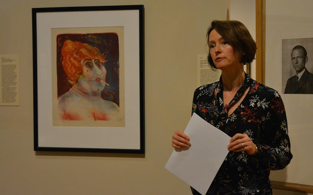 Julia Roos addresses an audience question next to a lithograph done by artist Otto Dix. This event took place Wednesday afternoon in the Eskenazi Museum of Art.