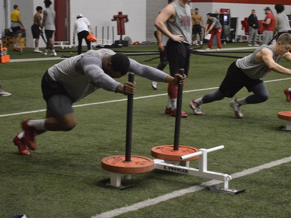 IU football players run through drills during practice in 2017 at John Mellencamp Pavilion. IU Athletics announced Friday that athletes or staff members tested positive for COVID-19, and workouts will continue on a voluntary basis.