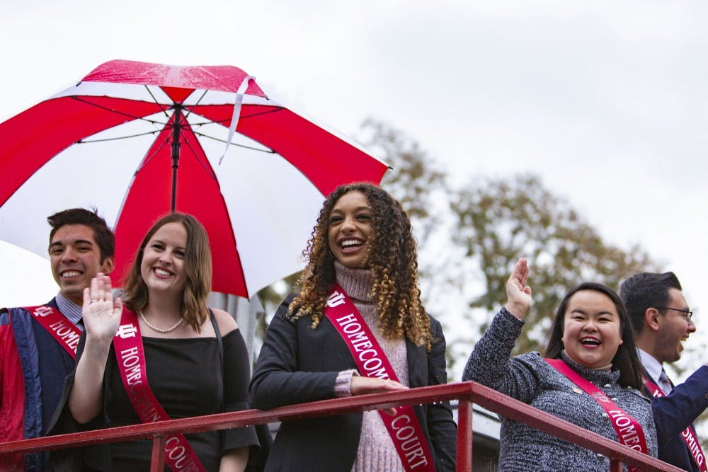 <p>From left, 2018 Homecoming court sophomore Andres Ayala,  and seniors Maggie Hopkins, Olivia Malone and Angela Perez look at the crowd Oct. 12, 2018, during the Homecoming parade on Woodlawn Avenue. </p>