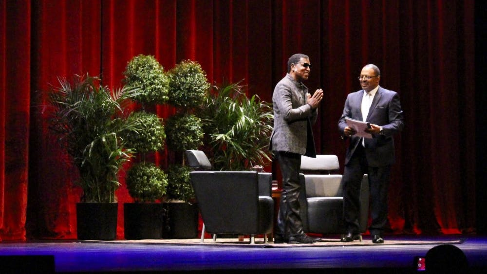 """Kenneth """"Babyface"""" Edmonds stands alongside James A. Strong as attendees welcome him to a Q&A. Edmonds received an honorary doctoral degree from IU."""
