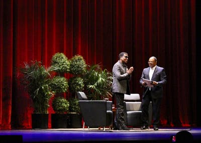 "Kenneth ""Babyface"" Edmonds stands alongside James A. Strong as attendees welcome him to a Q&A. Edmonds received an honorary doctoral degree from IU."