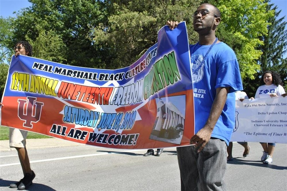 <p>Then-senior Darren Broady and IU Office of Community and School Partnerships employee Jamel Dotson lead the Juneteenth Parade June 19, 2010 down Third Street. Juneteenth is an annual celebration commemorating the ending of slavery in the United States. </p>