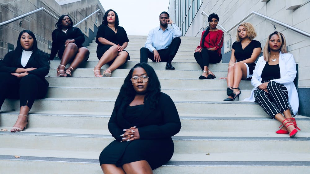 The Black Collegians executive board, from left to right, Machaia Carter, Ciera Howleit, Carrington Parran, Tiera Howleit, Damorion Page, Trenise Buchanan, Amaya Smith and Naudia Thompson, pose for a photo. The group focuses on encouraging Black students to get involved in civic and political conversations at IU.