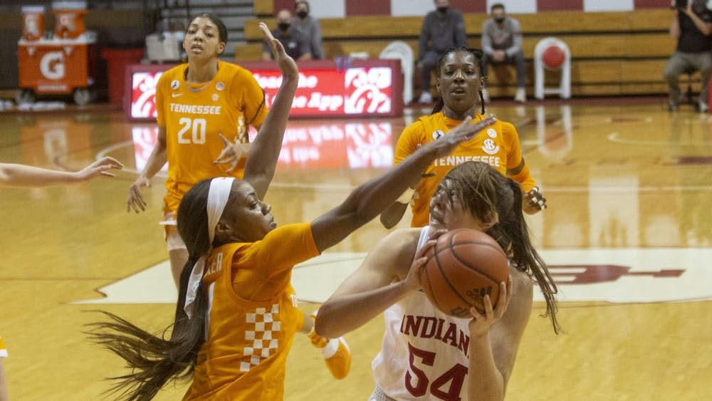 Sophomore Mackenzie Holmes looks through her ponytail to line up a shot in the game against the University of Tennessee on Dec. 17 in Simon Skjodt Assembly Hall. No. 15 IU lost 66-58.