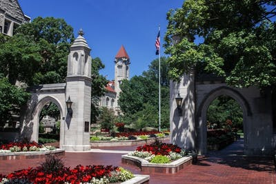 Sunshine illuminates the Sample Gates on June 28, 2019, on the IU-Bloomington campus. IU's 2020-21 calendar was recently announced.