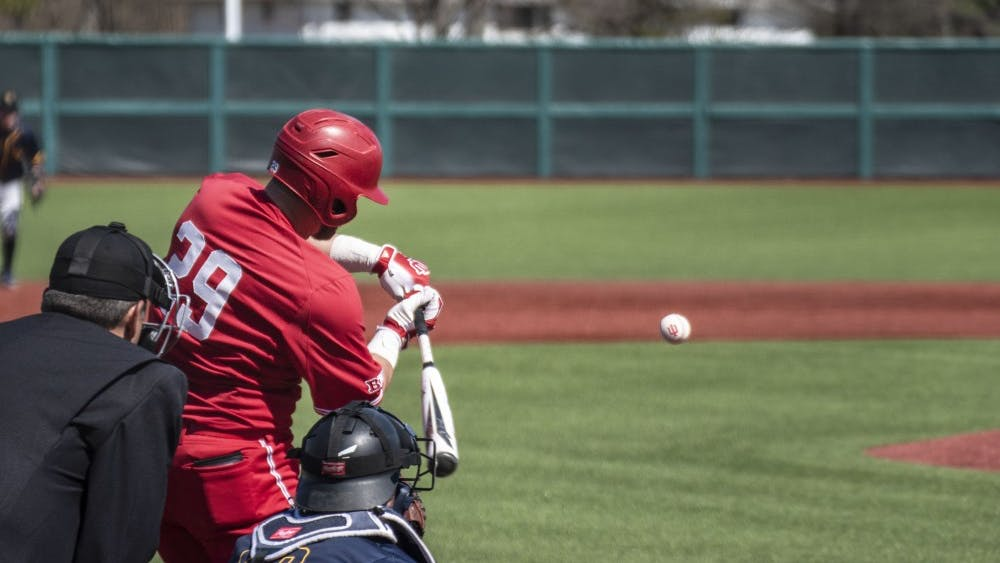 Senior catcher Ryan Fineman swings at a pitch March 17 at Bart Kaufman Field. Indiana defeated Canisius College to improve to 11-8 on the season.