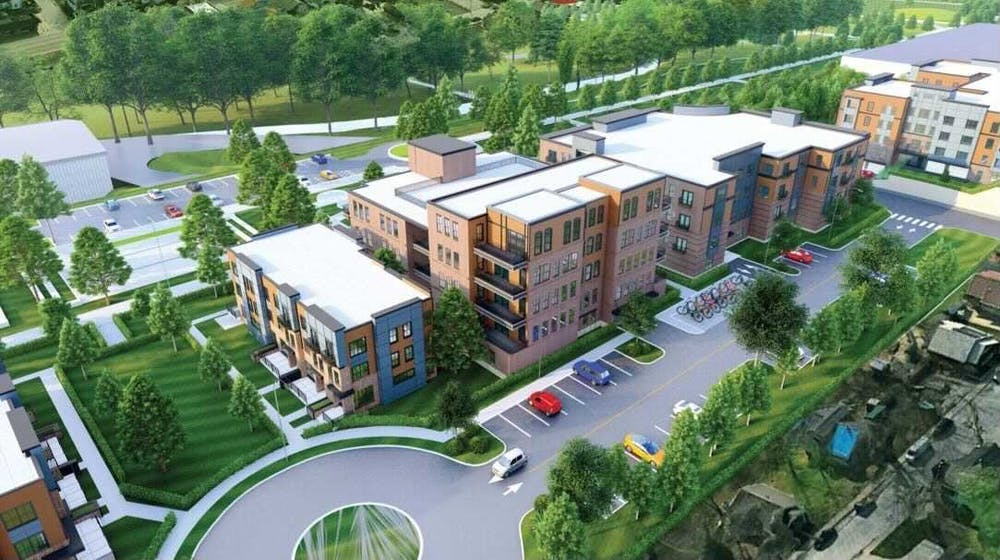 <p>An illustration shows one possible rendering of a building complex under consideration by the Bloomington City Council. The proposed site sits adjacent to Switchyard Park and is a multi-building complex that contains townhomes, apartments and commercial outlets.</p>