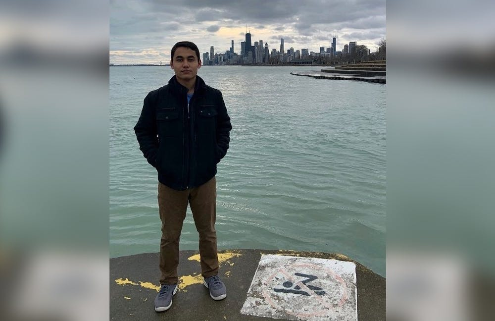 <p>Sophomore Dilyar Muradil stands for a picture. Muradil was born in Kashgar, a city in Xinjiang, China. </p>