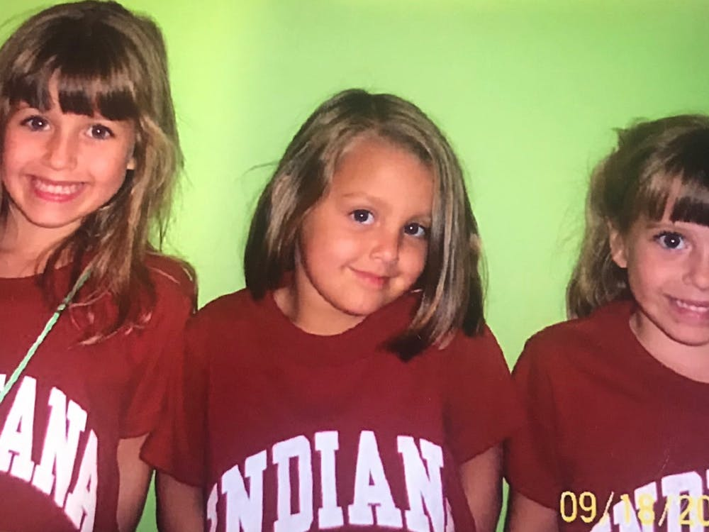 Five-year-old Ellie, Maddie and Ronnie VanBuskirk smile for a photo. The three were the first set of triplets to be born at the Bloomington hospital.