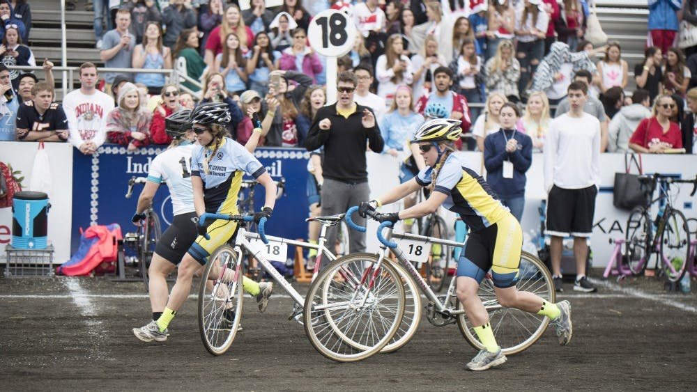 The Independent Council trades off bikes during the women's 2017 Little 500 race. Independent Council cyclists Hayley Kwasniewski and Celine Oberholzer started a petition to change the women's race to be as long as the men's race, with 200 laps.