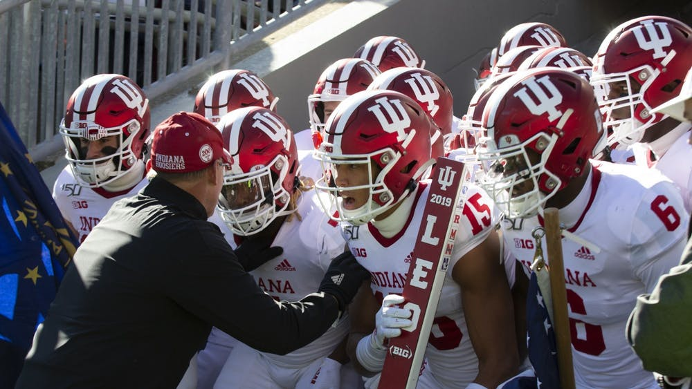 IU football head coach Tom Allen sways with his team before running out of the tunnel Nov. 16, 2019, at Beaver Stadium in State College, Pennsylvania.