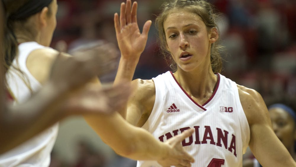Redshirt junior Ali Patberg high-fives teammates after making a free throw Nov. 17 in Simon Skjodt Assembly Hall. IU will play Wisconsin at 7 p.m. Thursday in Assembly Hall.