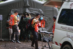 Rescuers work July 9, 2018, near the cave where 12 young soccer team members and their coach were trapped in Chiang Rai, Thailand.