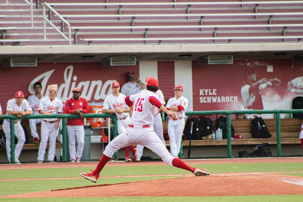 <p>Freshman pitcher John Modugno pitches against Illinois on Saturday at Bart Kaufman Field. The Hoosiers beat Illinois twice this weekend at home, with their third game being postponed Sunday due to weather. </p>