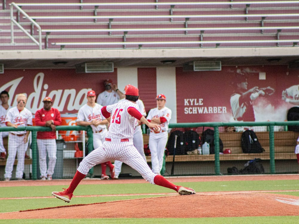Freshman pitcher John Modugno pitches against Illinois on Saturday at Bart Kaufman Field. The Hoosiers beat Illinois twice this weekend at home, with their third game being postponed Sunday due to weather.