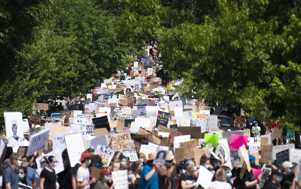 <p>Hundreds of protesters march June 5 down East  Seventh Street. The protest was in response to the killing of George Floyd by Minneapolis police officer Derek Chauvin and began in Dunn Meadow before making its way to courthouse square.</p>