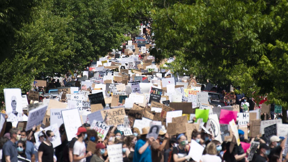 Hundreds of protesters march June 5 down East  Seventh Street. The protest was in response to the killing of George Floyd by Minneapolis police officer Derek Chauvin and began in Dunn Meadow before making its way to courthouse square.