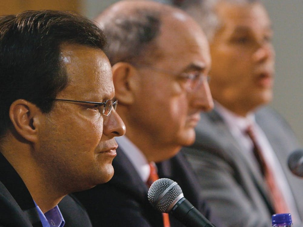 Chris Pickrell •IDSIU head basketball coach Tom Crean and IU president Michael McRobbie sit while IU Athletic Director Rick Greenspan speaks to the press Friday, June 6, 2008