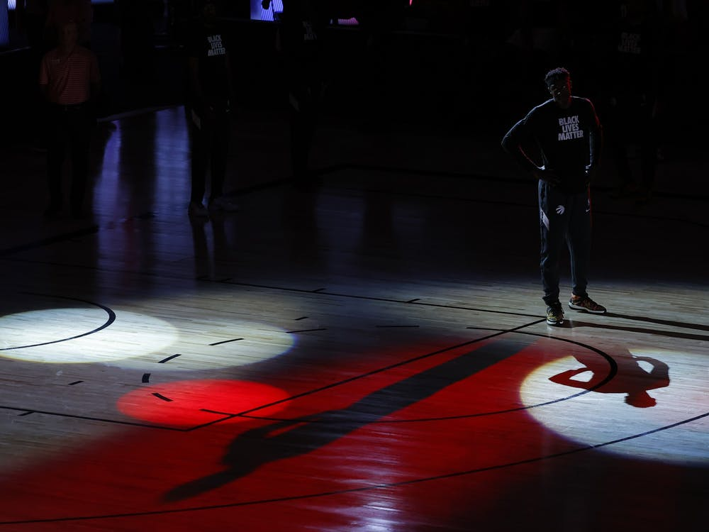 Pascal Siakam of the Toronto Raptors looks on during player introductions before the start of a game against the Brooklyn Nets in Game One of the Eastern Conference First Round during the 2020 NBA Playoffs on Aug. 17 in Lake Buena Vista, Florida. The NBA, WNBA, Major League Soccer and Major League Baseball postponed games Wednesday after some players went on strike in response to the police shooting of Jacob Blake on Sunday in Kenosha, Wisconsin.