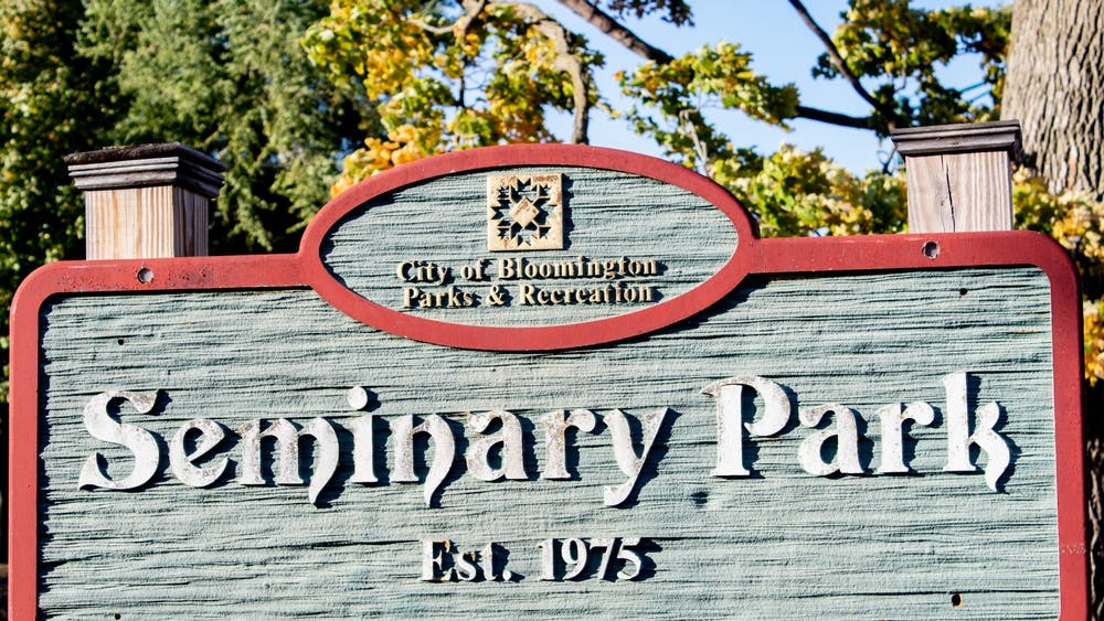 """A sign for the Seminary Park is seen on 100 W. Second St. The Bloomington Board of Park Commissioners approved the """"Public Health in the Parks"""" program Sept. 1 and allotted $50,000 toward the program, which strives to support the community at Seminary Park with medical and personal resources."""