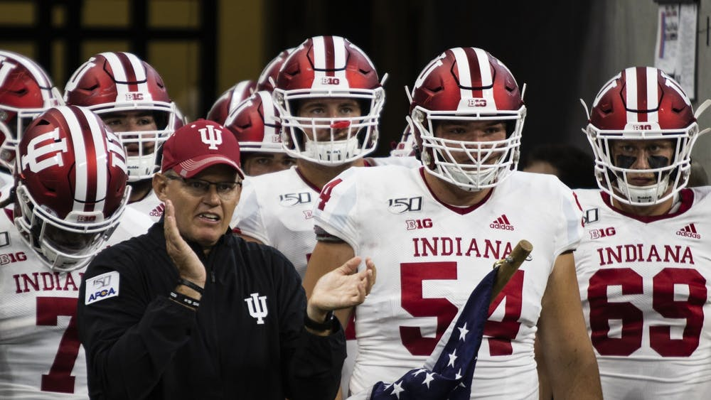 IU football head coach Tom Allen leads players onto the field Aug. 31, 2019, at Lucas Oil Stadium in Indianapolis. Four-star 2021 quarterback Donaven McCulley announced his commitment to IU football Thursday on Twitter.