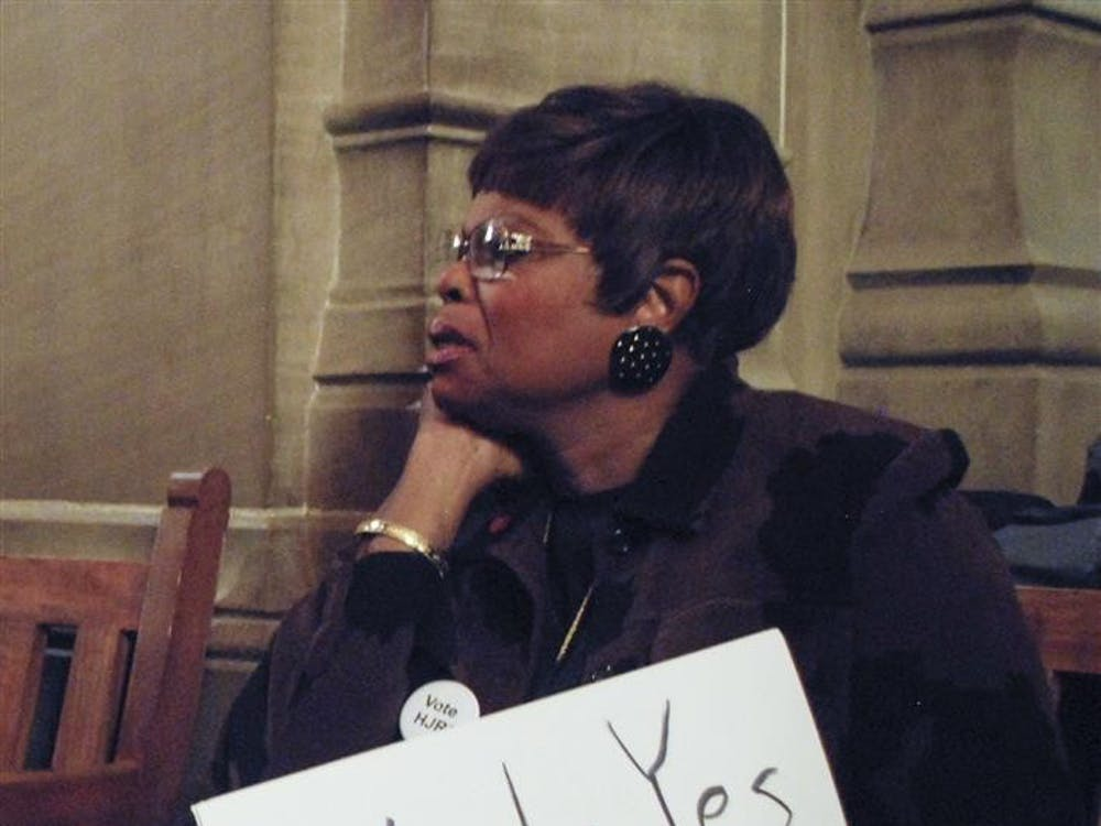 Jocelyn-Tandy Adande, president of the African American Republican Council of Marion County, watches the House Judiciary Committee hearing about H.J.R. 3. Supporters and opponents of the amendment came to the Statehouse on Monday expecting the committee to vote on the issue, but it was instead put off for an unannoucned later date.