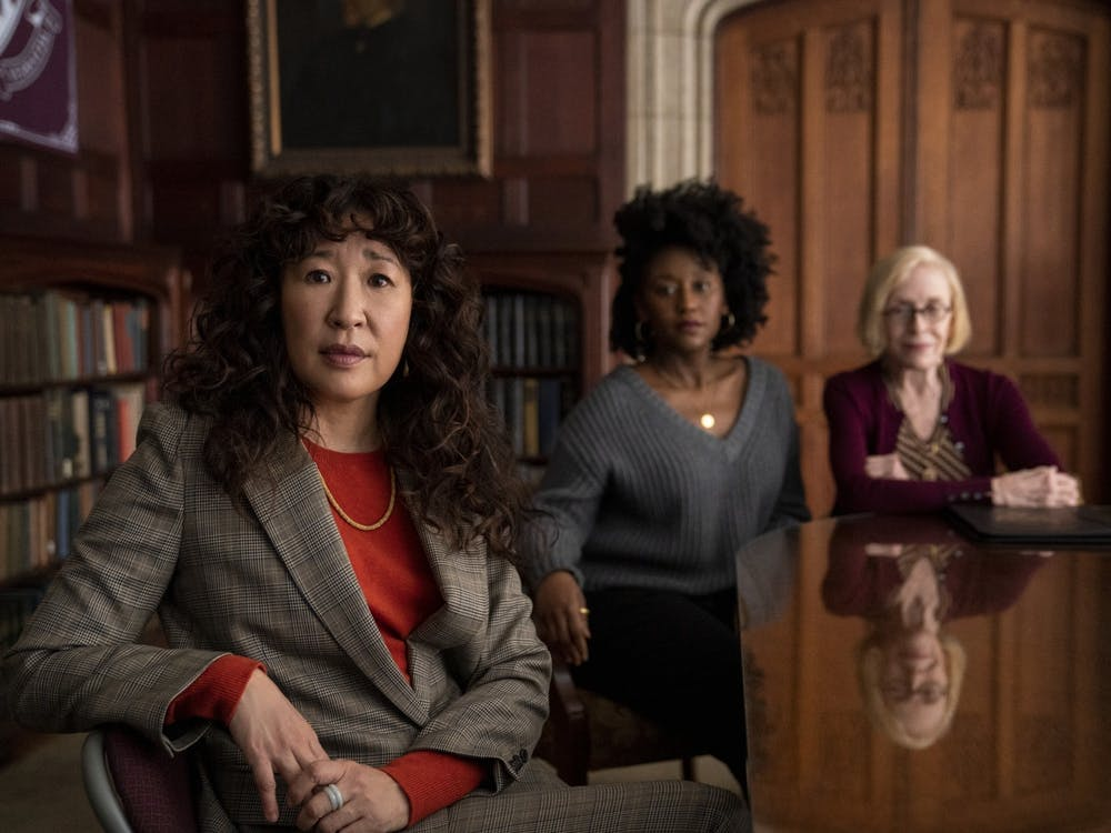 """Sandra Oh, Nana Mensah and Holland Taylor pose seated for their show, """"The Chair."""" The show  premiered to Netflix audiences Aug. 20, 2021."""
