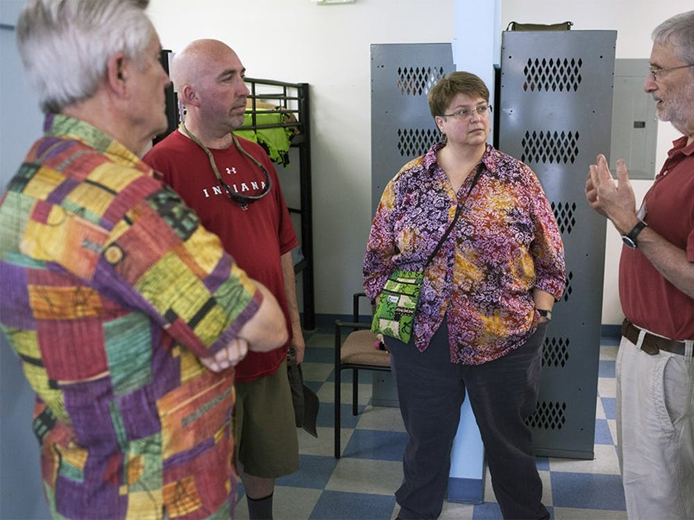 Dick Rose and Alan Backler, far left and far right and Board Members at the Shalom Community Center, give a tour of Friend's Place shelter during the Shalom Community Center open house hosted to introduce the shelter to the public Sunday afternoon.  Geoff McKim, center-left and member of the Monroe County Council, and Jean Capler, center-right and advocate for transgender rights in the Shalom Community Center, are both residents who hope that the transition to the new shelter will help shelter and rehabilitate those looking for residence in the future, they say.